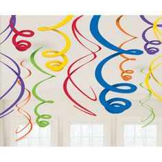 Fill the air with swirling beauty when you hang Rainbow Plastic Swirl Decorations. The decorations feature dangling swirls in assorted colors that add visual excitement to the party room. Each pack in