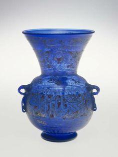 EGYPT Mosque Lamp - Mid-14th c. - Glass, enamel and gilt decoration,  26.7 cm (h.), 17.8 cm (diam.)  Gift of Harry A. Norton, inv. 1934.Dg.5