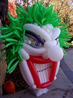 Scary clown balloon sculpture for Halloween party decor. Wicked Joker Clown!