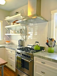 kitchen (designed by Katie Denham) interior, open shelves, kitchen shelves, cleanses, range hoods, bricks, subway tiles, countertop, open shelving