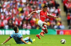 Flying: Arsenal's Alexis Sanchez skips a challenge during the Community Shield against Man...