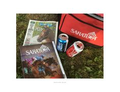 """For the most avid of Saratoga fans what's better than an afternoon at the Spa's backyard with a copy of the Daily Racing Form, the track program and a couple of """"Buds"""" with some friends?    An image bonus...American Pharoah on the DRF Program!"""