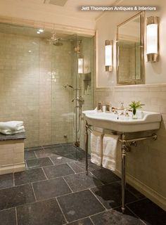 In LOVE with this bathroom. Belgian Bluestone on the floor. creamy rustic tiles on the wall. Love the vanity.