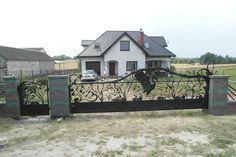 wrought-iron gate with heron www.kowartpodhale.com