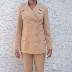 Camel jacket and pants suit Two piece camel colored jacket and pants. Great piece for a job interview or upcoming professional event. Pants are 40 inches. The pants in the bottom picture are taken in different lightning (indoors) while the other pictures are outdoor. The first three pictures are more representative of the color. Jackets & Coats