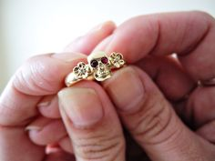gold skull ruby wedding ring For me, white gold & white center stone w/ amethyst on sides