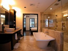 Luxury master bath....the shower looks a lot like ours. I need to pin a picture of our amazing shower.
