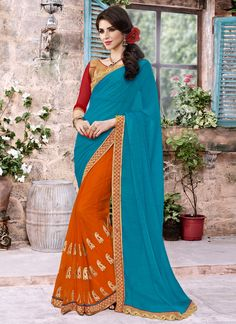 Add richer looks to the personality with this majestic blue and orange faux chiffon and net designer saree.. Beautified with embroidered and patch border work all synchronized effectively with all the...