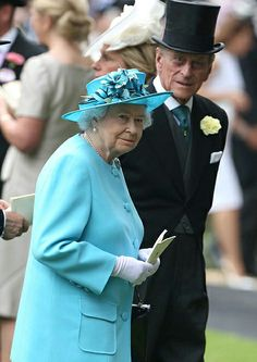 Queen Elizabeth II was elegant in turquoise accompanied by Prince Philip,  Duke of Edinburgh perched in the landau on day three of Royal Ascot 2014
