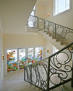 Ocean-front luxury - glass nautilus inserts at iron balustrade, and 'under-the-sea' stained glass at doors...