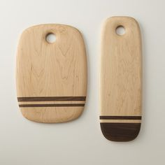 Crafted from select walnut and maple hardwoods, this Schoolhouse Electric exclusive is handmade by Los Angeles-based Dominik Woods Cutting Boards. Its soft, round edges, seamless joints, and pebble-like thinness create a timeless piece perfect for serving charcuterie or slicing up a farmer's bounty. The surface is hand sanded for a smooth finish, while a blend of beeswax and food-safe mineral oil help to both protect and enhance the wood's natural beauty. We recommend applying a liberal coat…