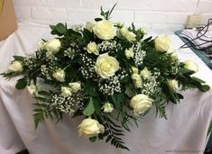 Gorgeous white rose table centerpiece for top table #weddingvenueflowers |Wedding Flowers Liverpool, Merseyside - Specialist Bridal Florist | Flower Delivery Liverpool - Same Day Delivery option | Florist Liverpool | Flower & Gift Shop Liverpool