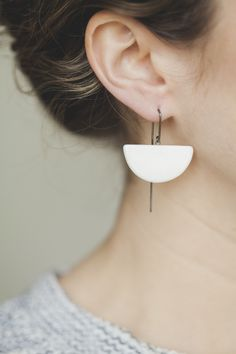 Minimal and elegant ceramic half moon earrings by independent designer Jessica Wertz