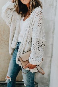 Pretty white cardigan over white tee and distressed denim jeans.