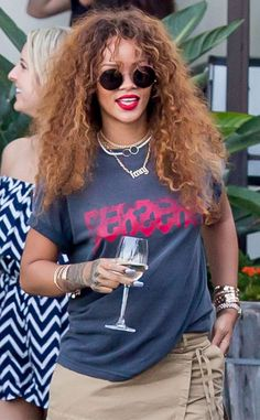 From her wildly curly locks, to her hippy round sunnies, to her bold red lip, we love Rihanna's crazy cool style!