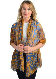 A gold and blue patterned semi-sheer scarf the perfect boho chic piece. Pair this scarf with flip flops and a sundress for a relaxed daytime look.
