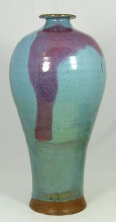 "LARGE CHINESE MEI PING JUN YAO GLAZE VASE Glazed in blue with a splach of crimson red from shoulder to body. Underglaze vase. Circa Ming Dynasty period. Measures 15"" height x 6 1/2"" diameter"