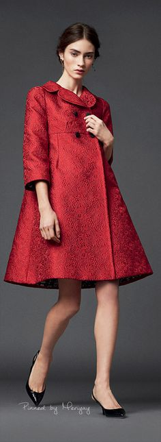 Dolce & Gabbana. This red coat holds a similar trait as a 1950s coat. The…