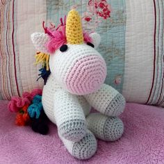I crocheted this cute unicorn for my God daughter's communion. It's  smaller version of a toy design by 1dogwoof.com