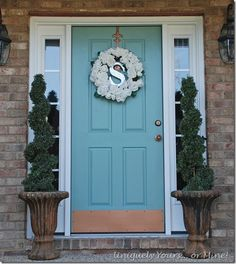 Custom blue painted front door, paint is a color match to Annie Sloan's Duck Egg. Aged Copper sprayed door hardware