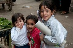 Some young Egyptian girls playing at the market in Alexandria, Egypt.