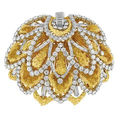 Gold, Platinum and Diamond Flower Pendant-Clip-Brooch The textured gold petals accented by 146 round and 55 baguette diamonds approximately 9.50 cts., approximately 48 dwt