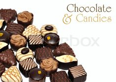 Image of 'hand made chocolate candies over white background'
