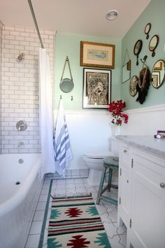 bathroom, color + white. I like the multiple textures & surfaces, even if art + steam don't mix.