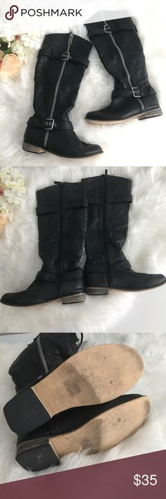 Black Boots Sit just below the knee. Wide enough for wide calves. Accent zipper on outer side with buckle and functional zipper on inner side. Wear on heels pictured. Shoes Combat & Moto Boots