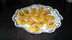 Rübli Schnitten: Try this Swiss-German recipe. It is delicious and easy to bake - www.GoRaRa.com. Photo: Momentum Design. http://www.gorara.com/carrot-cakelets-with-walnuts-on-a-bed-of-chocolate/
