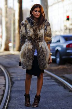Christine Centenera in a fur coat, black skirt & booties #style #fashion #streetstyle