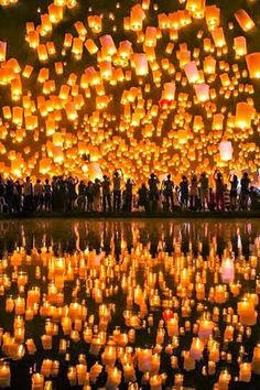 Floating Lantern Festival, Thailand... this looks beautiful, I'd love to see it someday