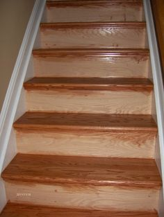 We installed new treads and risers then we stained and applied urethane.  Cost was right at $ 1500  13 steps.  Painted the risers white. 45230