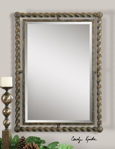 """Hand Forged, Metal Inner Frame Accented By A Twisted, Wrought Iron Outer Frame With A Heavy Rust Wash Finish. Mirror Features A Generous 1 1/4"""" Bevel. May Be Hung Either Horizontal Or Vertical."""