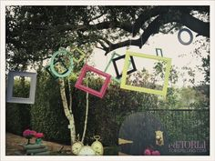 Love the hanging frames idea for a aprty