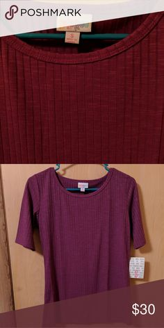 LulaRoe GiGi A beautiful, solid dark purple GiGi with a vertical ribbed texture. Size small and NWT. LuLaRoe Tops