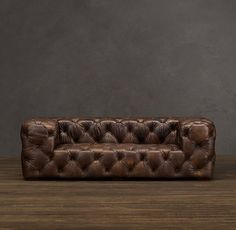 A twist on your typical 'chesterfield'. Would add a whimsical / modern touch to the library or parlor.