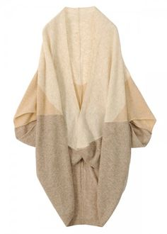 I Absolutely Love this Tsumori Chisato Cardigan!!!!This would look as well with a black tank, dark blue skinny or wideleg jeans and tall knee length boots of light brown.