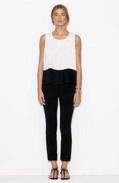 work wear, modest neckline and fit on top, fitted black ankle pants