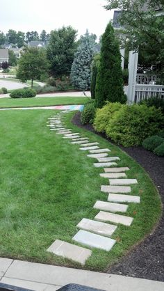 Pavers added to avoid wearing down the lawn.  It's a great idea and we like this look.