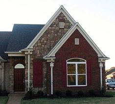 Perfect! 1462 sq. ft, 28' across, 2/2 down, 1/1 up (finish later?), garage.House Plan 47104 Elevation