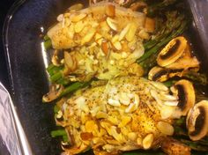 Lemon/pepper tilapia on asparagus and mushrooms topped with sliced almonds