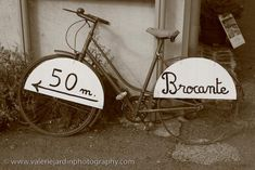 Old French bicycles often retire as shop signs…