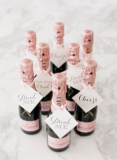 Give out pink champagne as a boozy wedding favor, your guests will love it.
