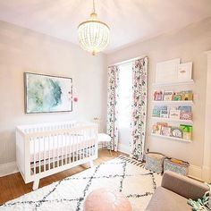 Stunning baby girl nursery - those floral drapes are perfection!