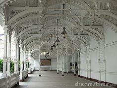 Wooden lace and a prospect of arches in Trzni kolonada (Market colonnade) in Karlovy Vary, Chech.