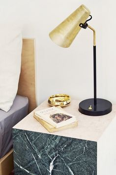 Bedroom nightstand with a perforated lamp