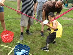 Water balloon sling shot (use exercise band and make target?)