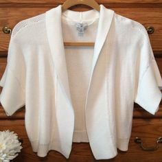 "Worthington White Shrug Beautiful crisp white shrug. 60% cotton and 40% rayon.  Has some weight to it. Approximately 18"" in length.  Barely worn. Worthington Sweaters Shrugs & Ponchos"