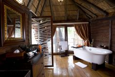 Your bubble bath is drawn. Doesn't this Serena Mivumo River Lodge hideaway have a romantic in the wild cottage feel?